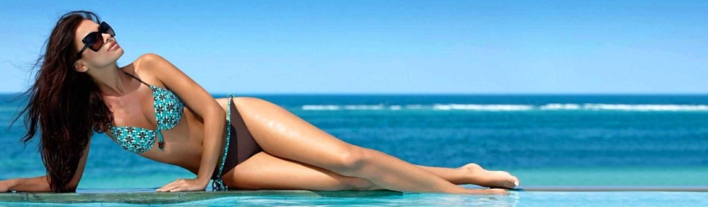 bikini-girl-laying-on-beach-rocks-wearing-sunglass-web-header